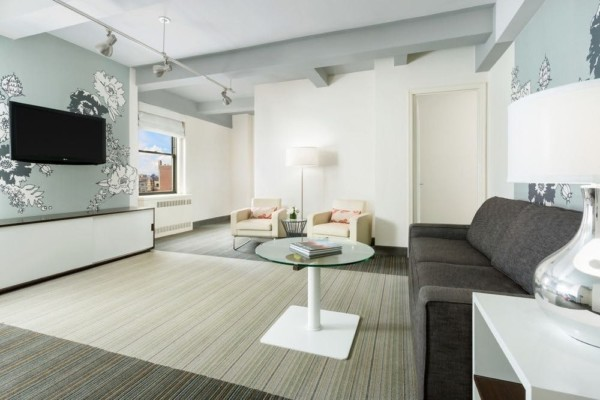 https://suiteness.imgix.net/destinations/new-york/stewart-hotel-new-york/suites/two-bedroom-suite-with-kitchen/living-room.jpg?w=96px&h=64px&crop=edges&auto=compress,format
