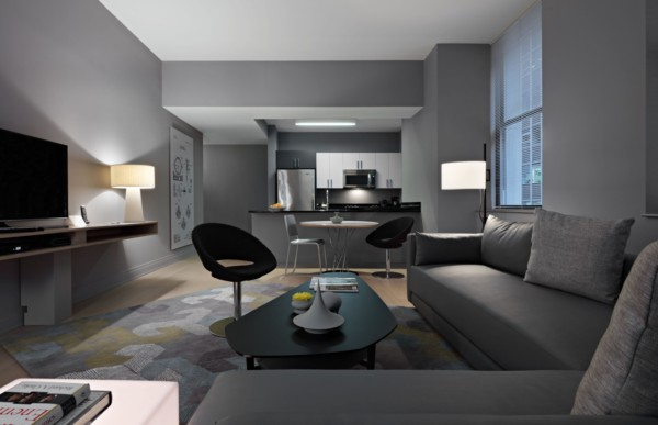 https://suiteness.imgix.net/destinations/new-york/q-a-residential-hotel/suites/two-bedroom-suite-one-bath/living-room.jpg?w=96px&h=64px&crop=edges&auto=compress,format