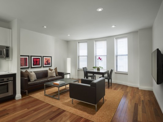 https://suiteness.imgix.net/destinations/new-york/aka-times-square/suites/two-bedroom-suite/aka-times-square-living-room-1.jpg?w=96px&h=64px&crop=edges&auto=compress,format