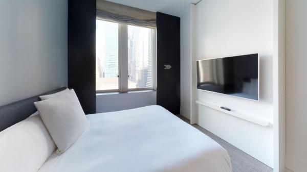 https://suiteness.imgix.net/destinations/new-york/andaz-5th-avenue/suites/two-bedroom-andaz-suite/bed-area.jpg?w=96px&h=64px&crop=edges&auto=compress,format