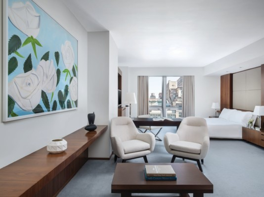 https://suiteness.imgix.net/destinations/new-york/langham-place-new-york-fifth-avenue/suites/junior-suite-junior-suite/junior-suite-bedroom-and-sitting-area.jpg?w=96px&h=64px&crop=edges&auto=compress,format