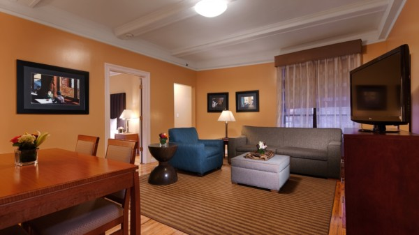 https://suiteness.imgix.net/destinations/new-york/best-western-plus-hospitality-house/suites/two-bedroom-apartment-suite-3-beds/living-room.jpg?w=96px&h=64px&crop=edges&auto=compress,format
