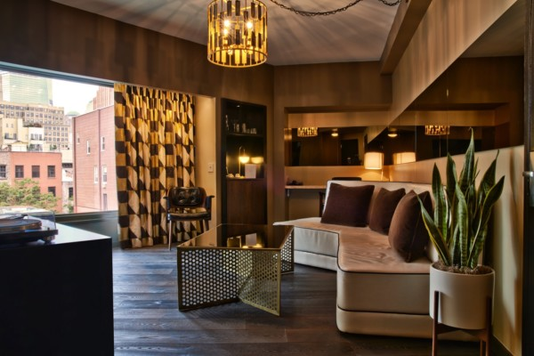 https://suiteness.imgix.net/destinations/new-york/the-roxy-hotel/suites/-deluxe-one-bedroom-suite-deluxe-double-double/Roxy-Deluxe-One-Bedroom-Living-Space.jpg?w=96px&h=64px&crop=edges&auto=compress,format